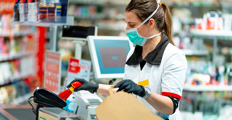 female cashier with mask