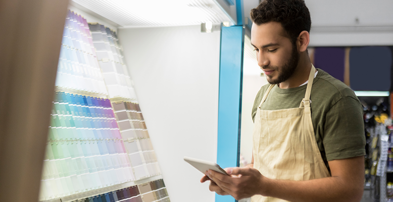 employee with paint colors